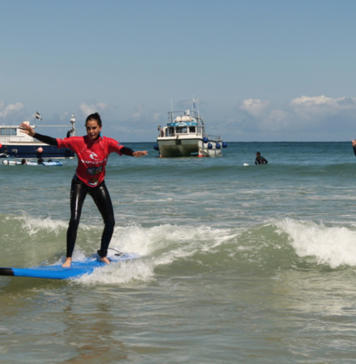 Teri Hatcher surfing in Cornwall